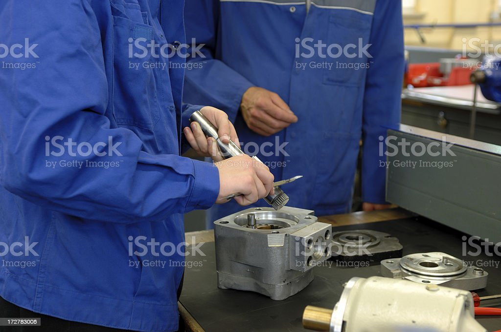 Two working machinists royalty-free stock photo