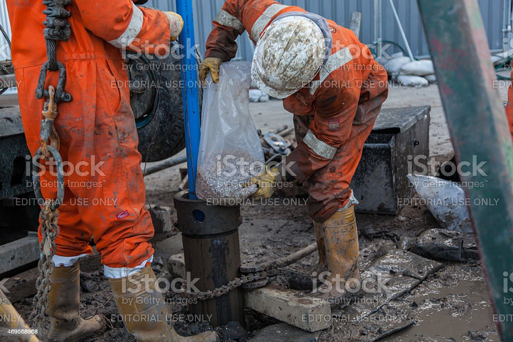 two Workmen and a borehole stock photo