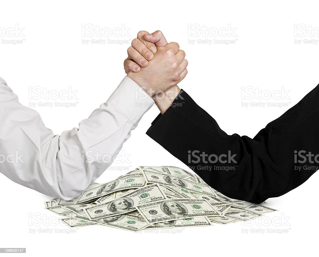 Two wrestling hands for money prize stock photo