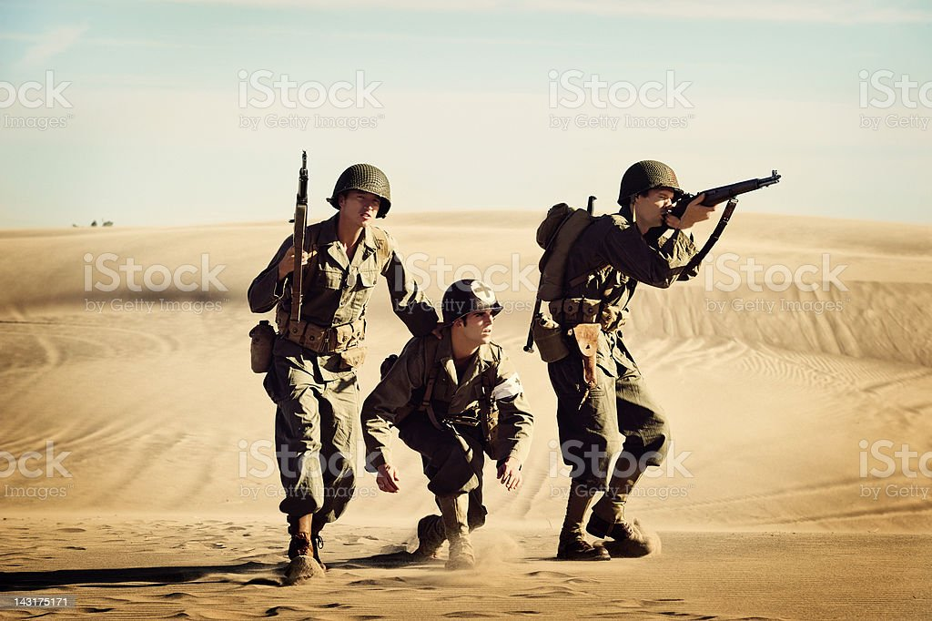 Two WWII Soldiers Protecting The Squad Medic royalty-free stock photo