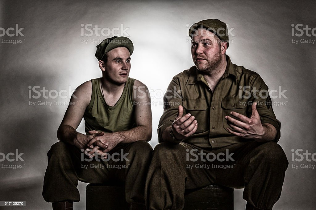 Two WWII US Army Bivouac Soldiers Relaxing Talking stock photo