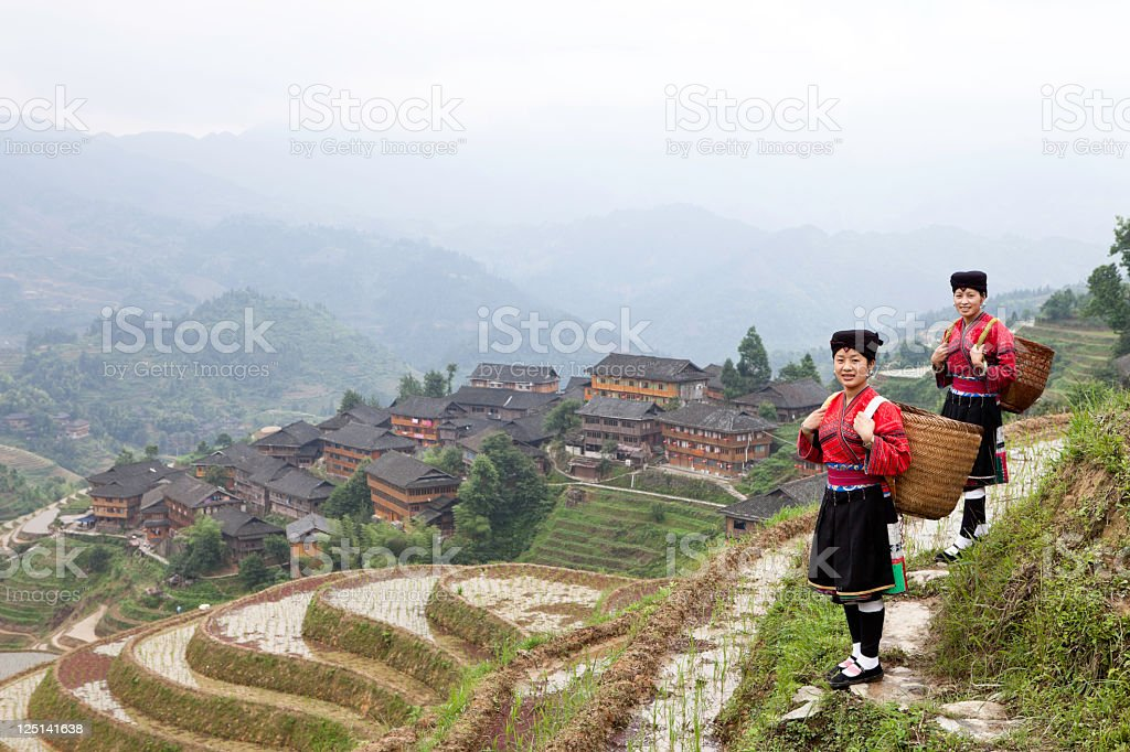 Two Yao ethnic minority with a view of a village royalty-free stock photo