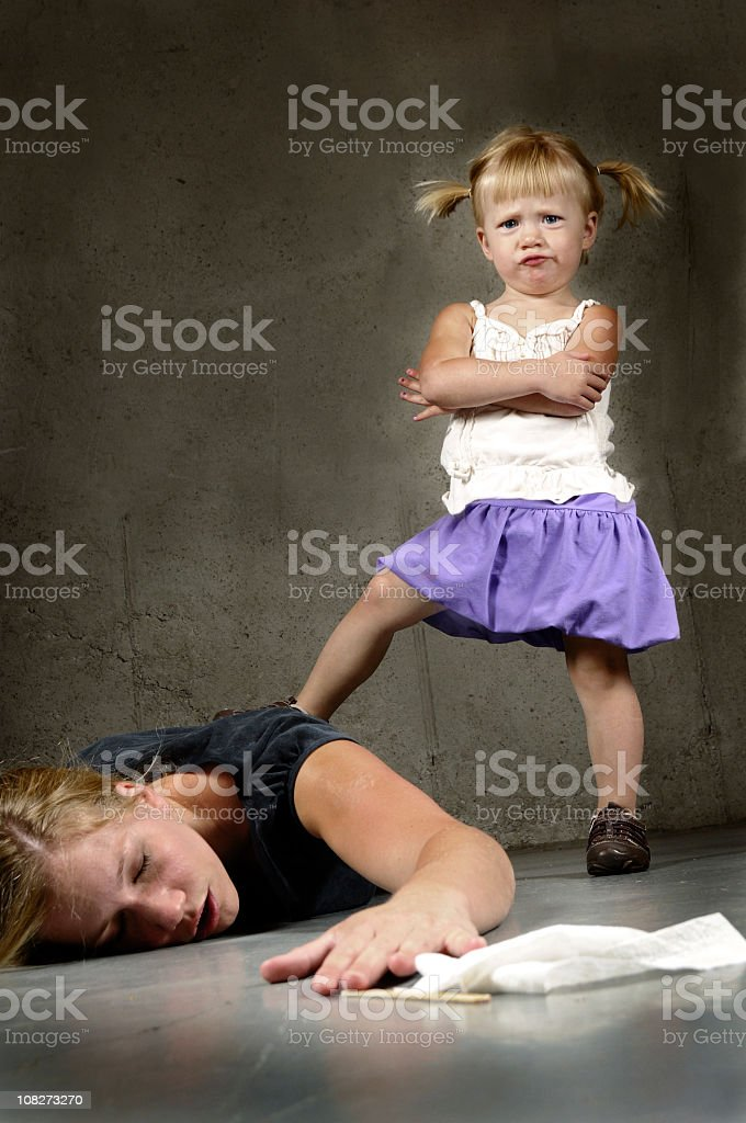 A two year old having a tantrum over her mother stock photo
