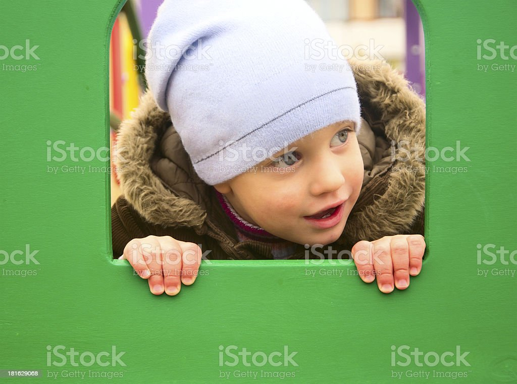 Two years boy on the playground stock photo