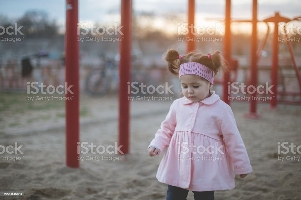 Two years old pretty girl outside stock photo