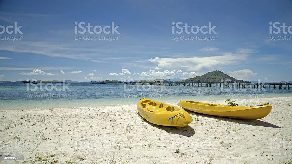 Two yellow canoe stock photo