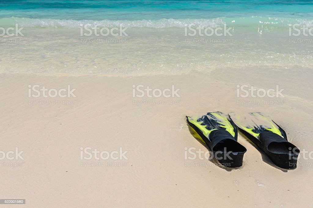 Two yellow flippers for diving stock photo