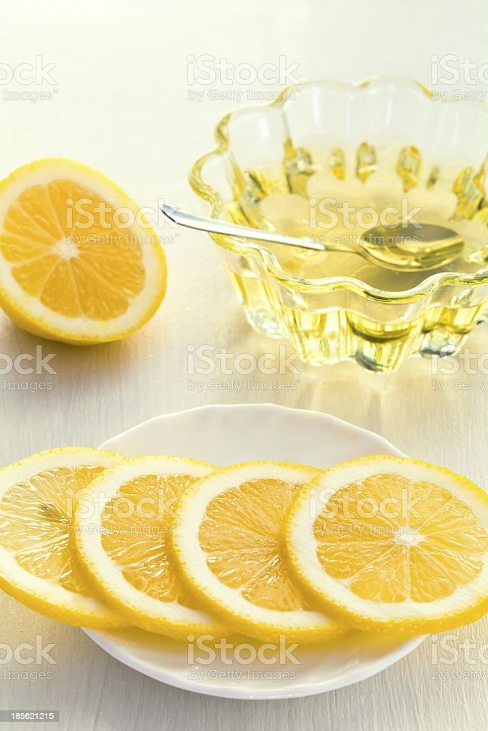 Two yellow lemon and honey glass cup royalty-free stock photo