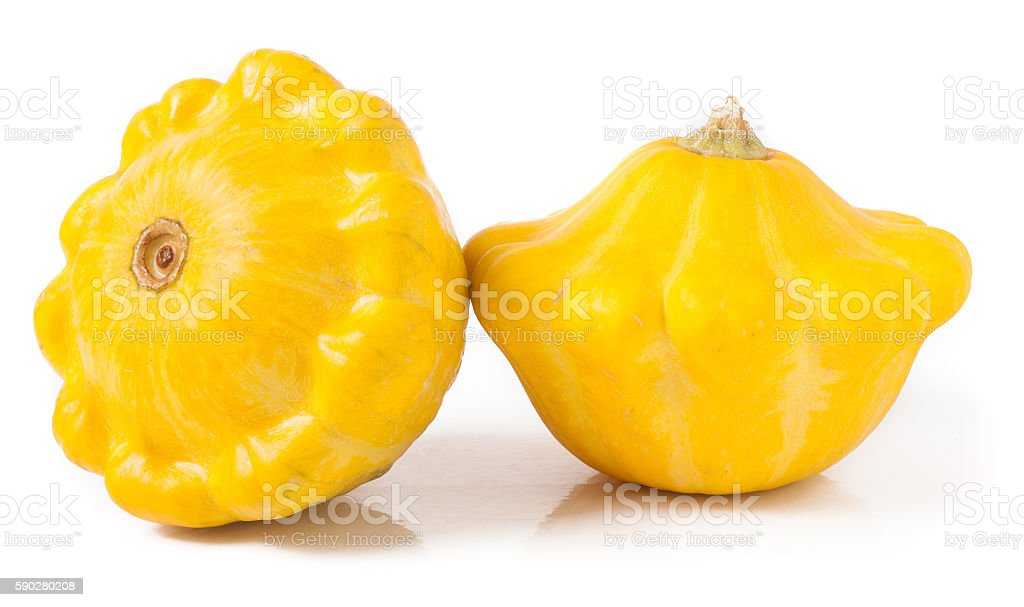 two yellow pattypan squash isolated on white background stock photo