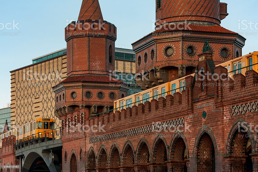 Two yellow trains on the Oberbaum bridge in Berlin stock photo