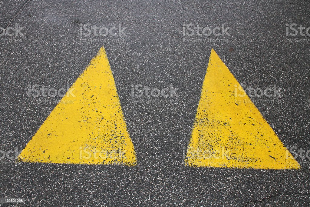 two yellow triangle road signs stock photo