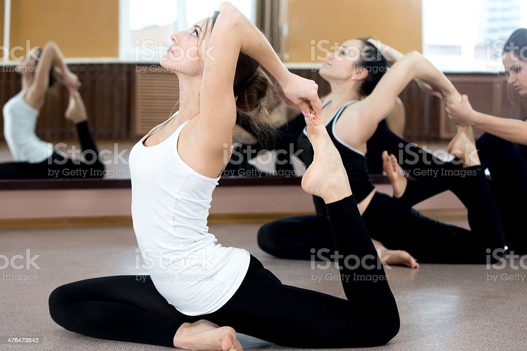 Two yogi female exercising in class stock photo