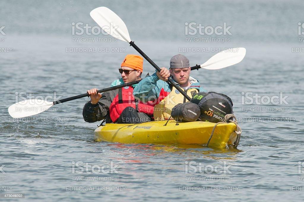 Two Young Adult Men Kayaking At Assateague stock photo