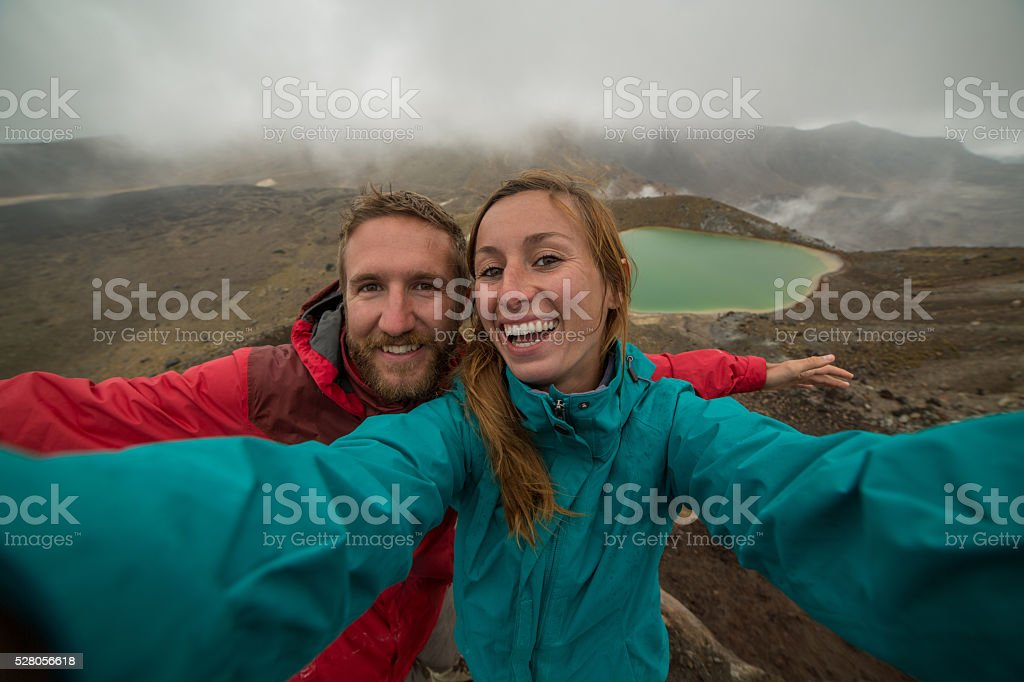 Two young adults capturing special moments in nature stock photo