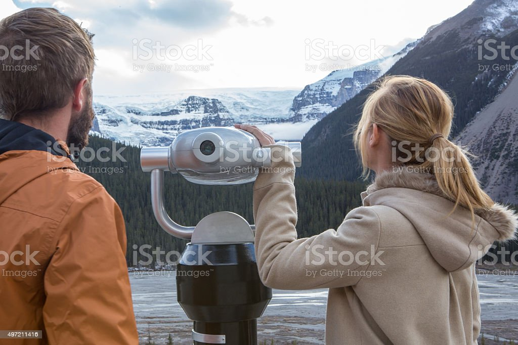 Two young adults looking at the glacier from viewfinder stock photo