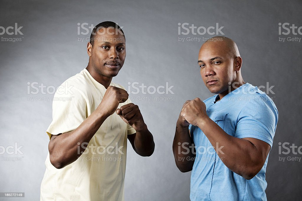 Two young african-american man in a defensive stance royalty-free stock photo