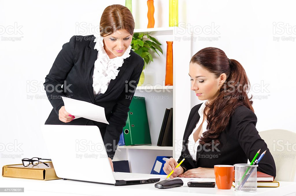Two young and pretty businesswomen working royalty-free stock photo