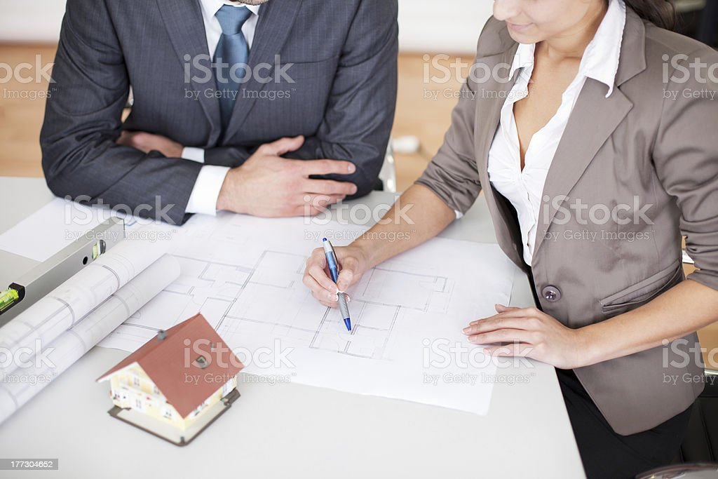 Two young architects in the meeting royalty-free stock photo