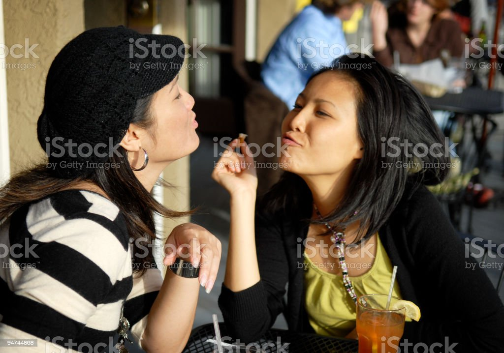 Two Young Asian Women Make Kissy Faces royalty-free stock photo