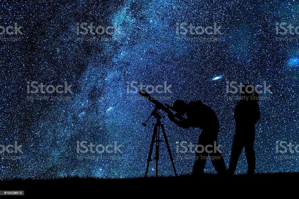 Two young astronomers observing Milky Way stock photo