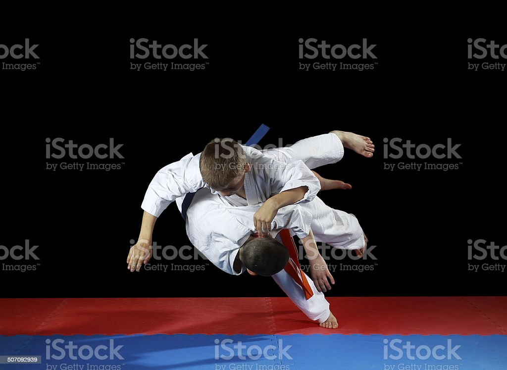Two young athletes in the sharp drop perform judo throw stock photo