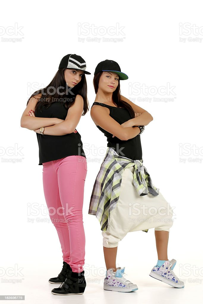 Two young attractive brunettes in hip hop outfit stock photo