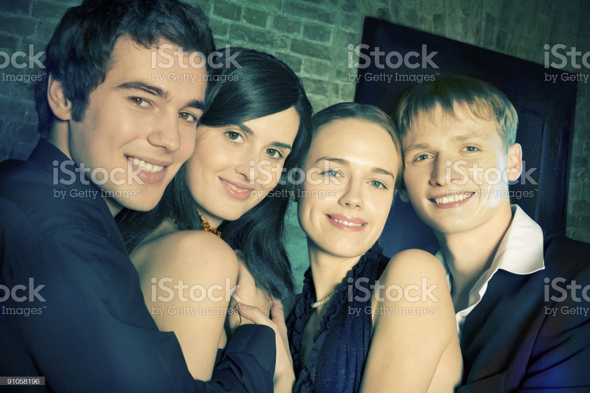 Two young attractive smiling couples or friends at a Party royalty-free stock photo