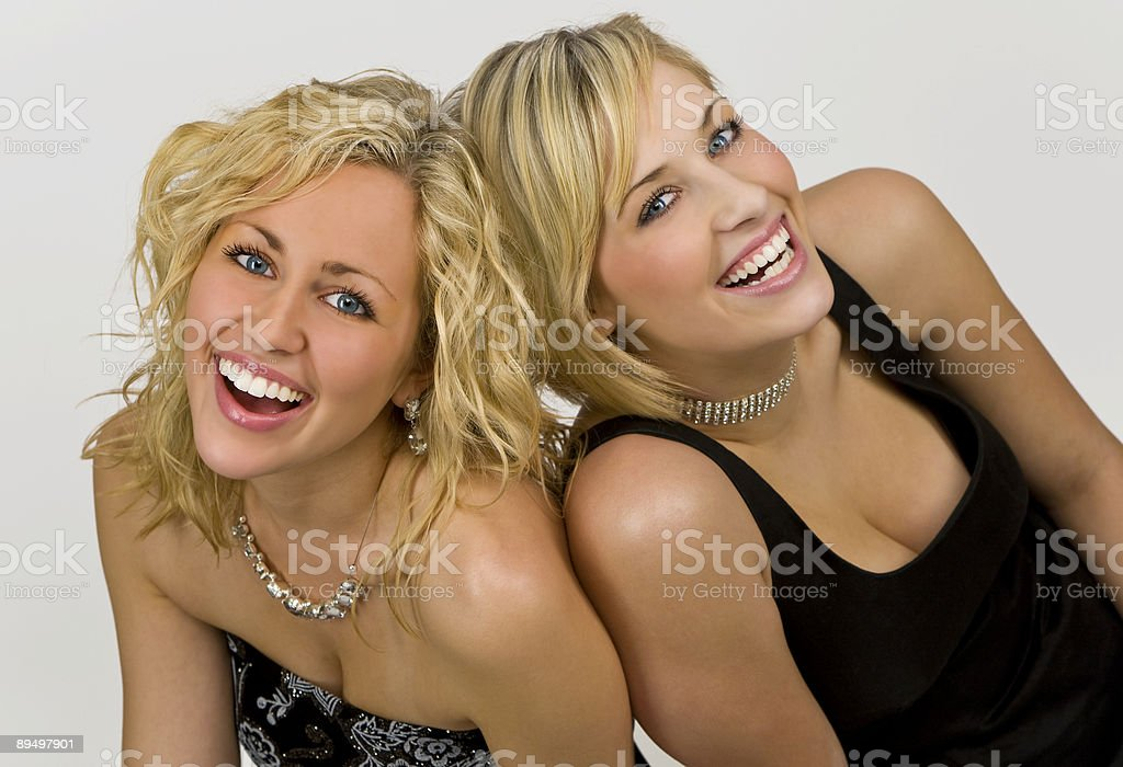 Two Young, Beautiful Blond Women Together Laughing Having Fun royalty-free stock photo