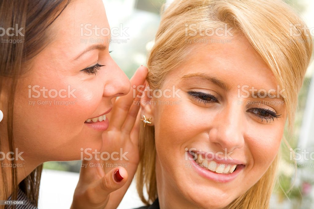Two young beautiful women chating - gossip royalty-free stock photo