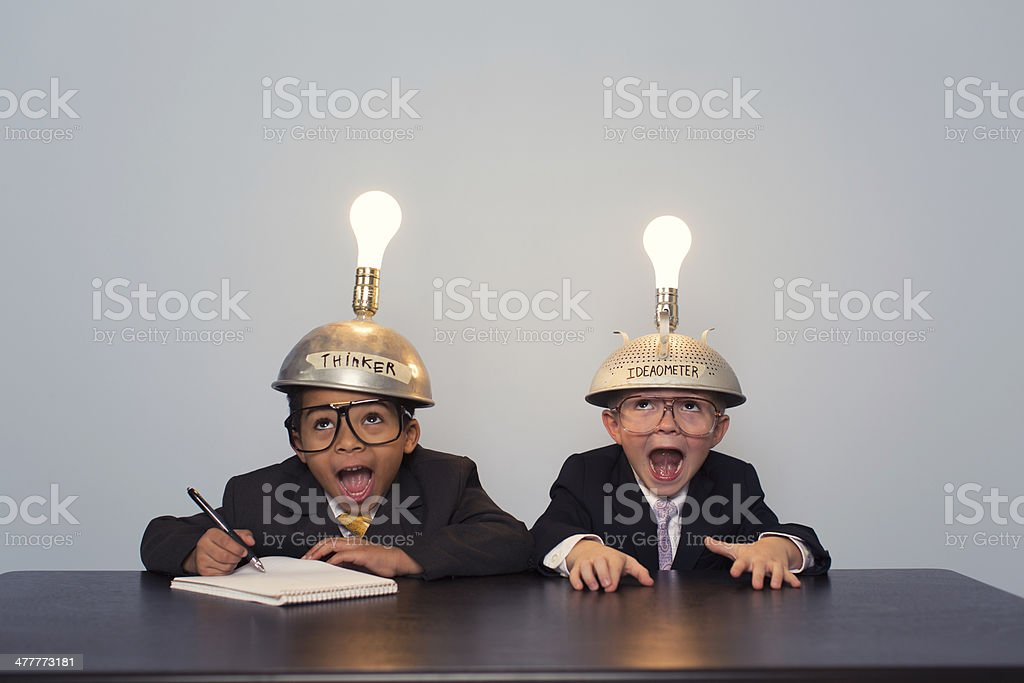 Two Young Boy Dressed in Suits and Thinking Caps stock photo