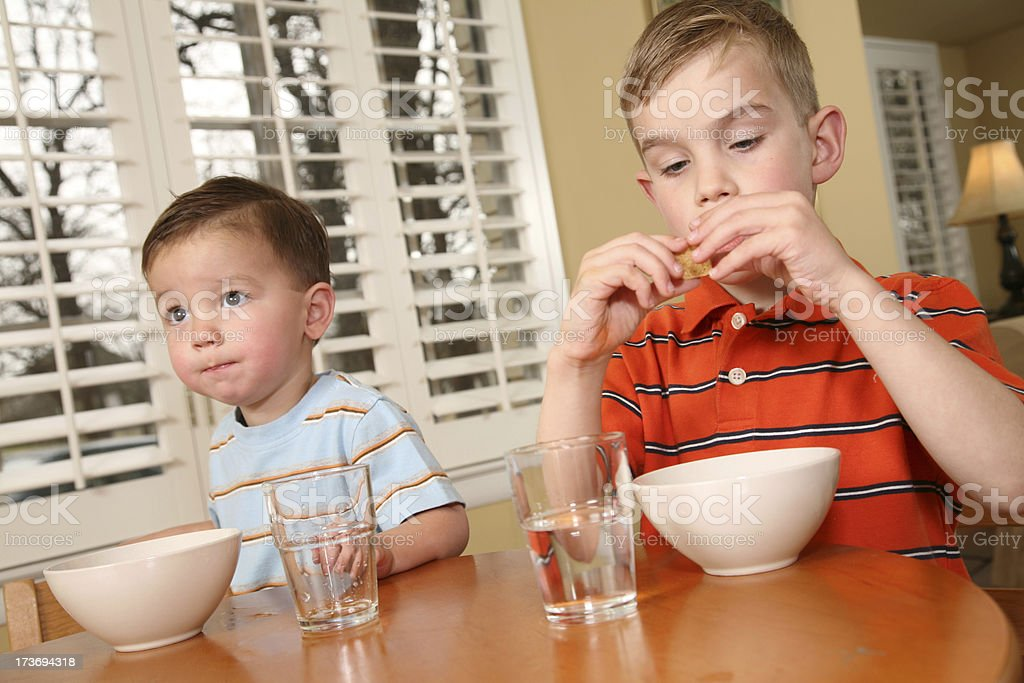 Two young boys having a snack royalty-free stock photo