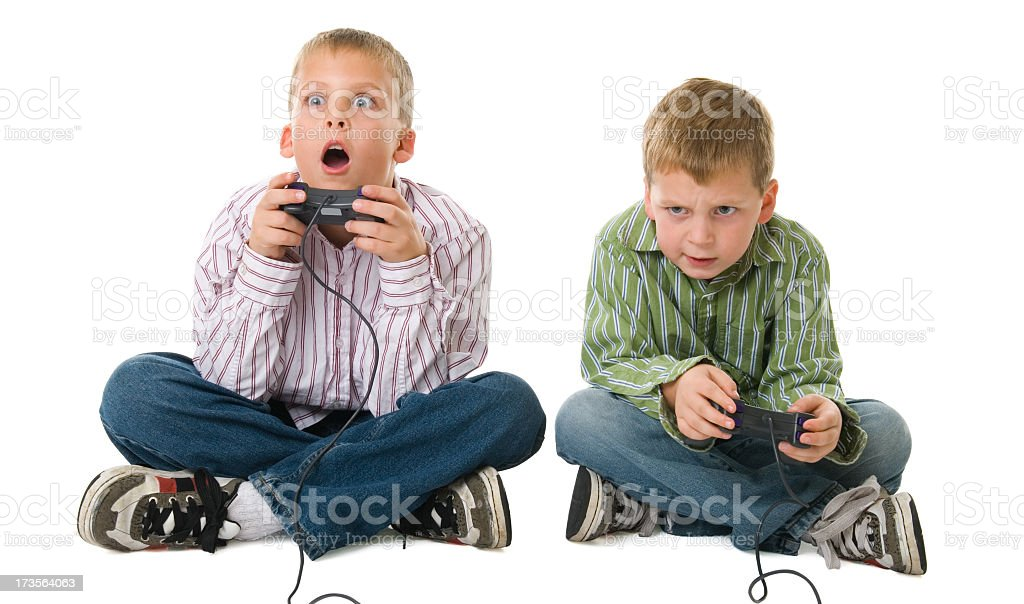 Two young boys holding game controllers royalty-free stock photo