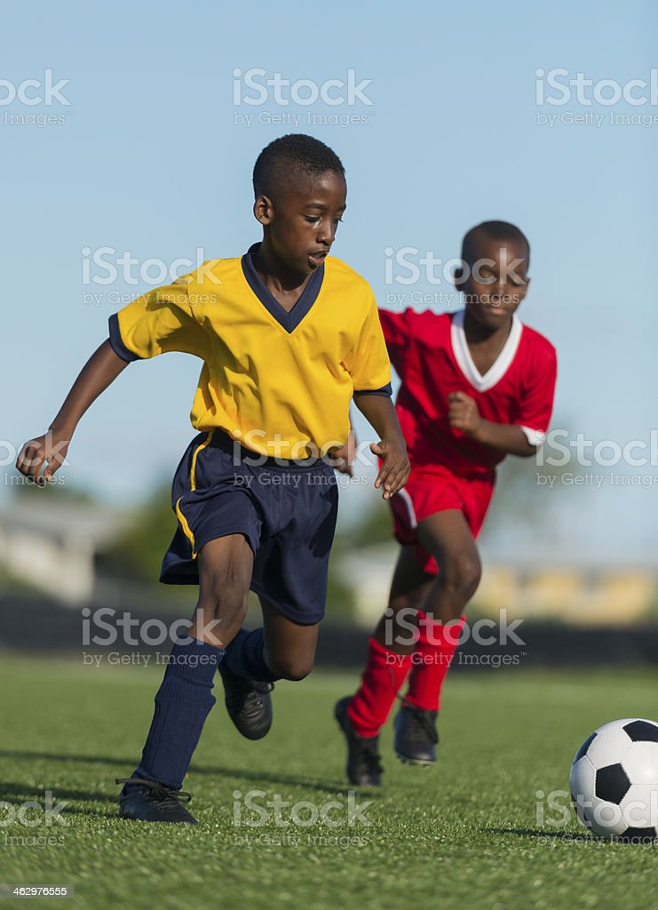 Two Young Boys Playing Football stock photo