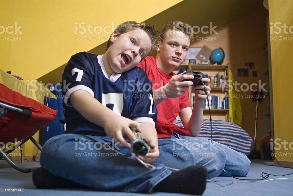 Two young boys playing video games royalty-free stock photo