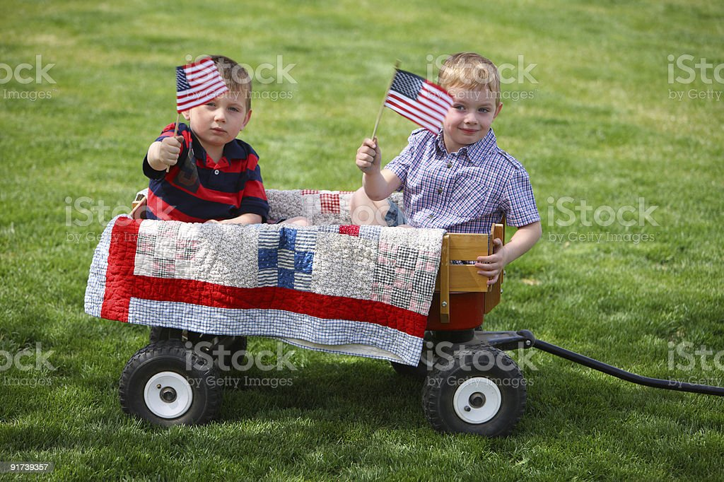 Two young boys waving American flags royalty-free stock photo