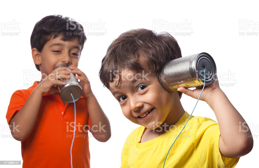 Two young boys with tin can phones stock photo