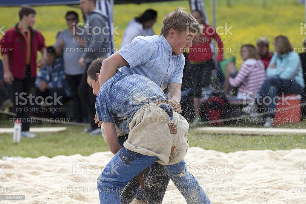 Two Young Boys Wrestling, Lenk, Bernese Oberland stock photo