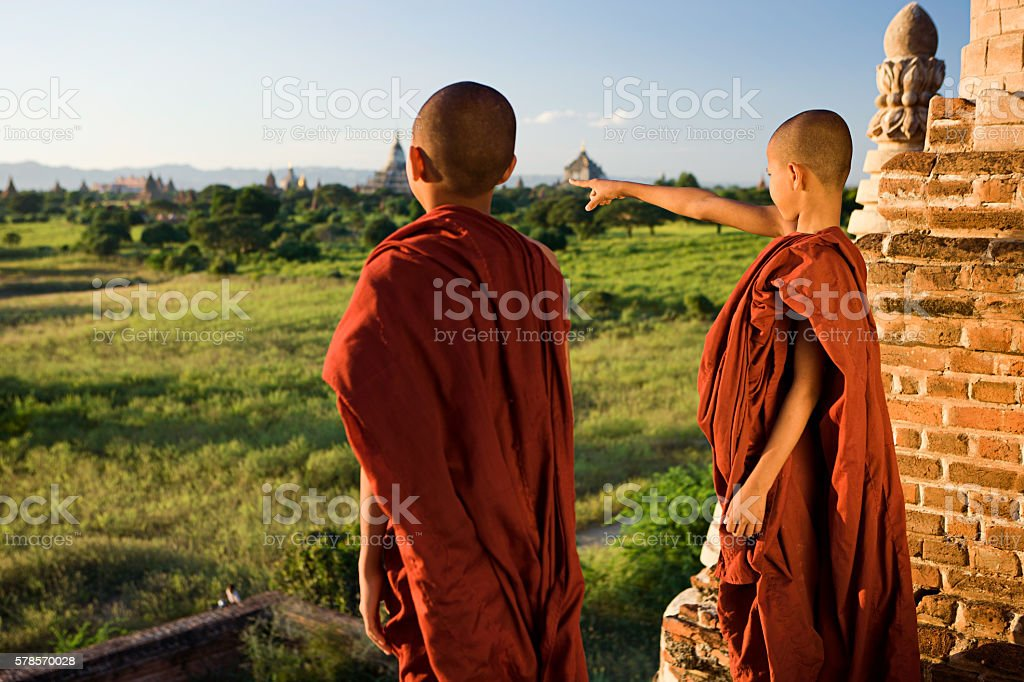 Two young Buddhist monks looking at a view in Bagan stock photo