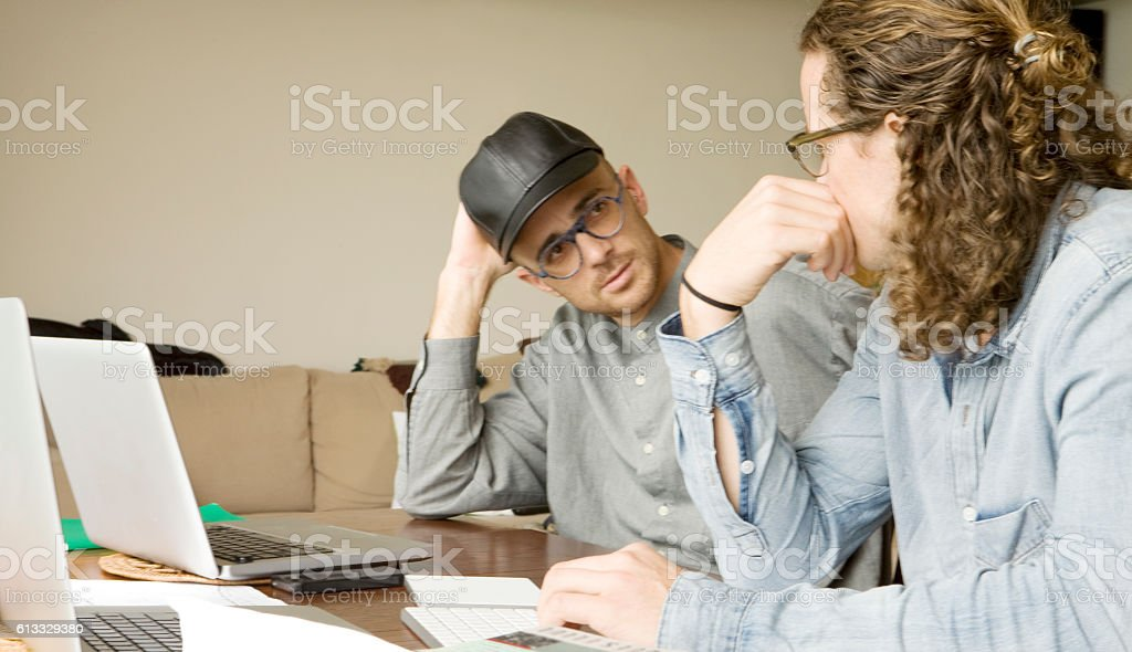 Two young business men in a collaboration discussion stock photo
