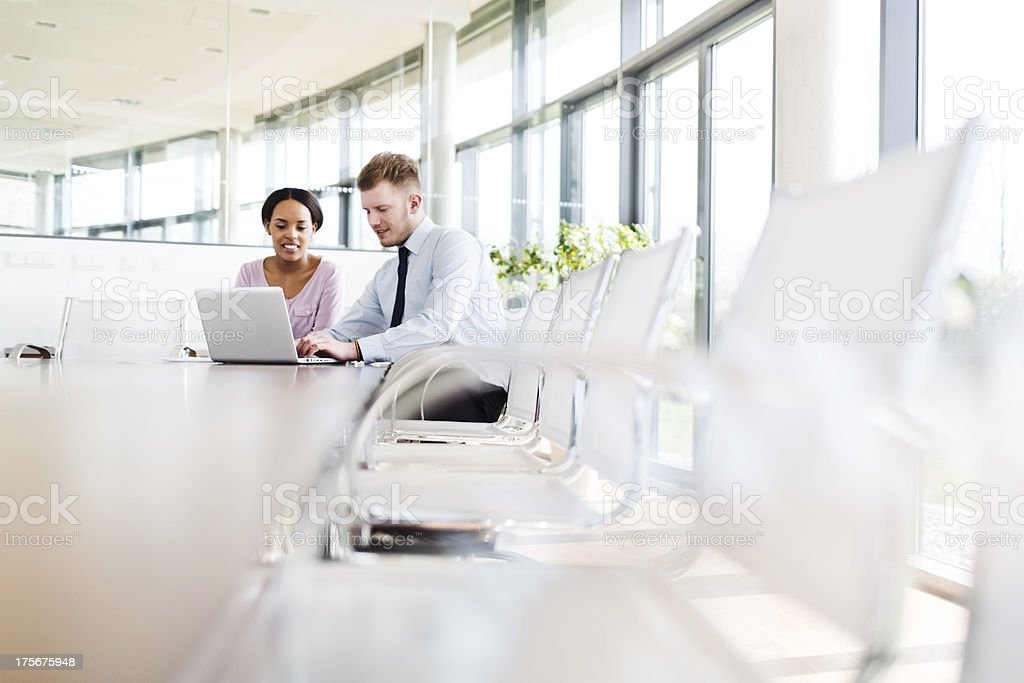 Two Young Business People in Modern Office stock photo