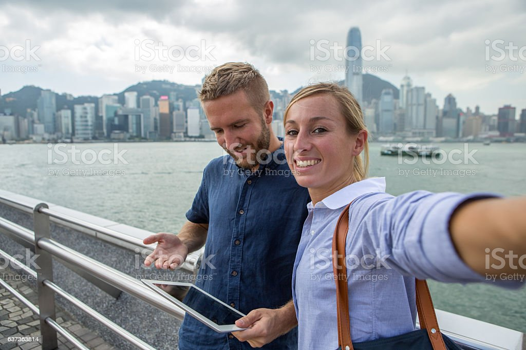 Two young business people taking selfie portrait in Hong Kong stock photo
