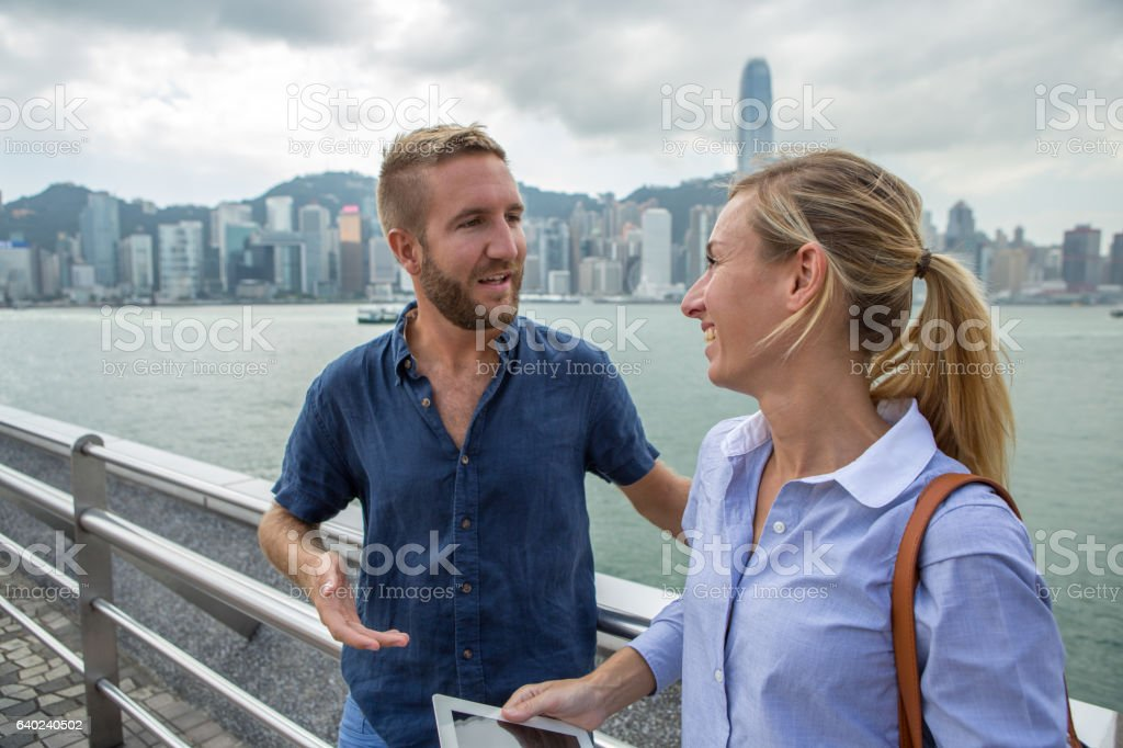 Two young business people using digital tablet in Hong Kong stock photo