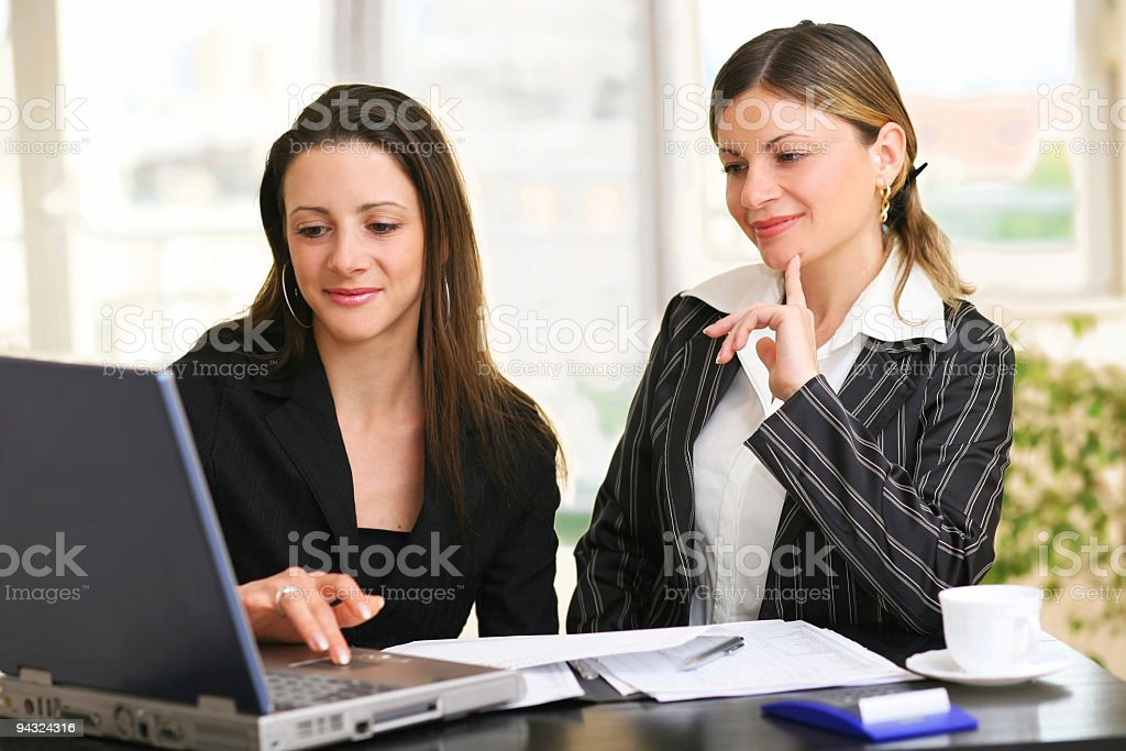 Two Young business woman working on laptop royalty-free stock photo