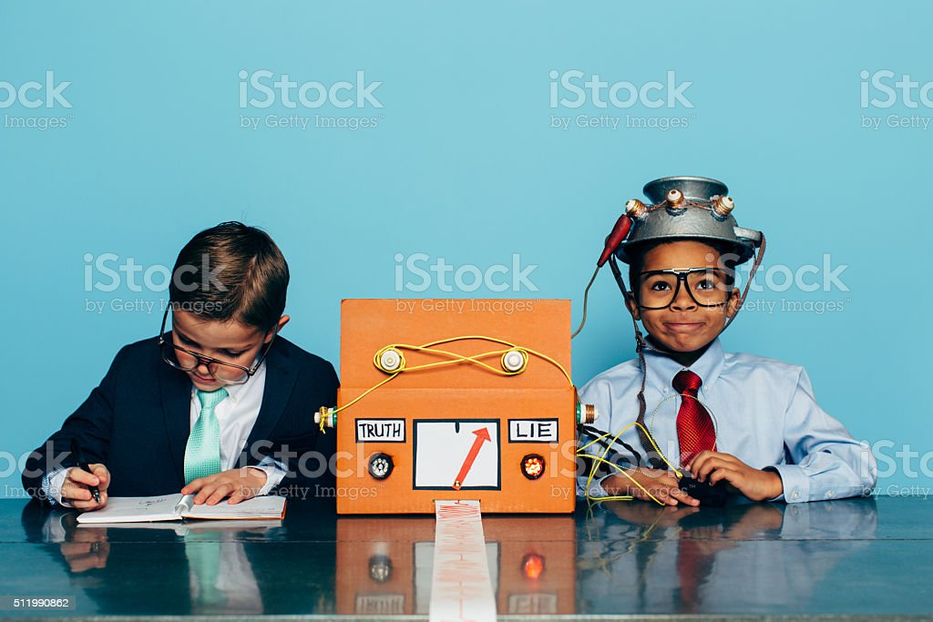 Two Young Businessman with Lie Detector stock photo