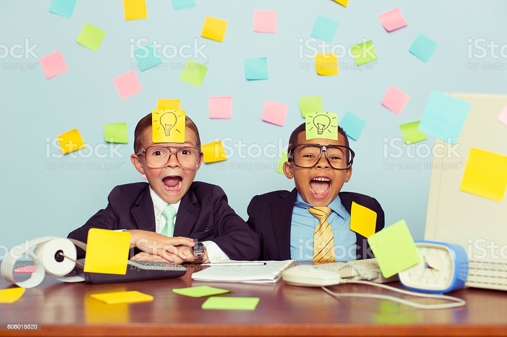 Two Young Businessmen Covered with Light Bulb Sticky Notes stock photo