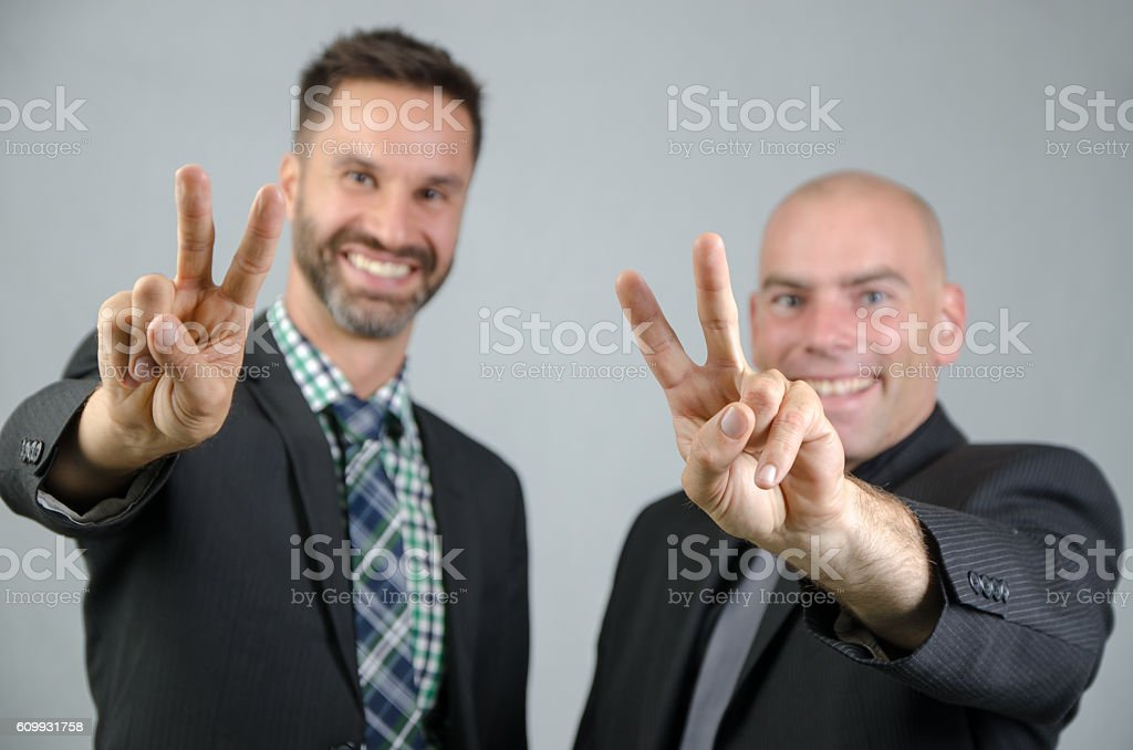 Two young businessmen in studio stock photo