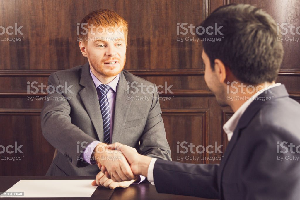 Two Young Businessmen Making Agreement stock photo