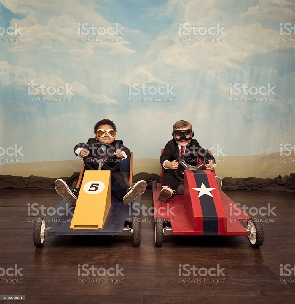 Two young businessmen race each other stock photo