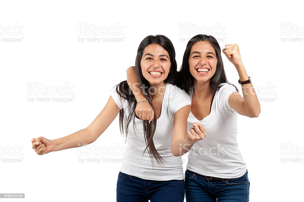 Two young cheering girls stock photo
