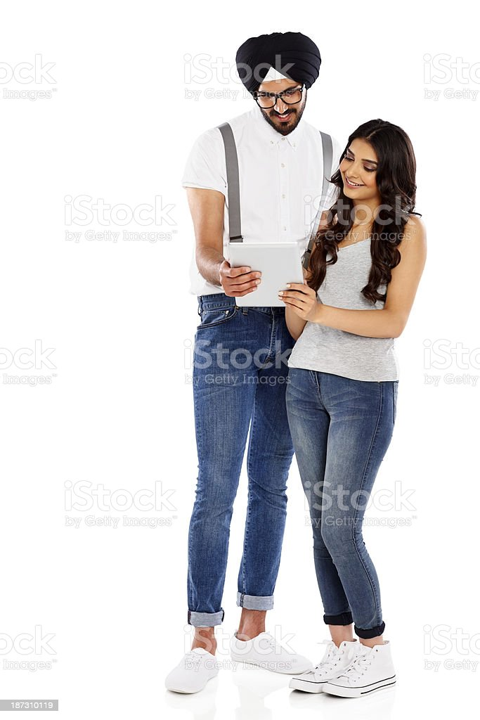 Two young college students using digital tablet royalty-free stock photo